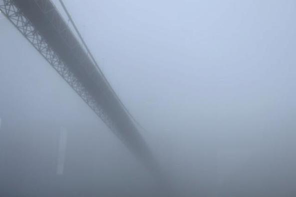 A bridge hidden in fog near Bergen, Norway