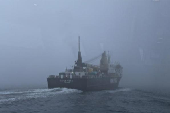 A ferry hidden in fog near Bergen, Norway