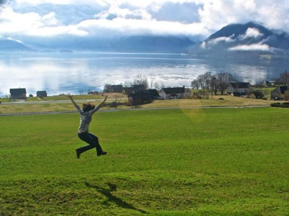 Jumping beside the fjord in Rosendal, Norway
